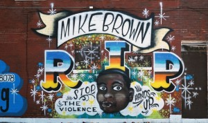 Figure 1.  This striking image of a mural dedicated to Mike Brown is one of the items added to the Documenting Ferguson collection.  http://omeka.wustl.edu/omeka/items/show/8736