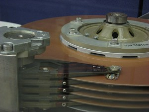 Figure 6. Close-up of a disk drive at the Computer History Museum, showing arms and a read/write head. Processing Born-Digital Materials Using AccessData FTK at Special Collections, Stanford University Libraries, 2011.