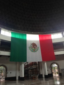 Image 4.  The central foyer of the Archivo General de la Nación, with a massive dome in the place of the old prison watchtower and the Mexican flag centrally positioned as one enters the space (taken by the author in 2015).