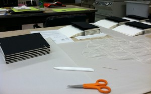 Binding an edition of artists' books.